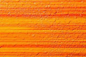 fundo de listras laranja molhado foto