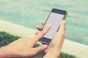 telefone inteligente na mão foto