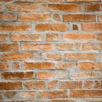 close-up de parede de tijolos antigos foto