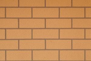 fundo de parede de tijolo marrom foto