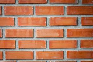 fundo de parede de tijolo vermelho foto