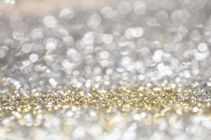 bokeh de glitter ouro e prata foto