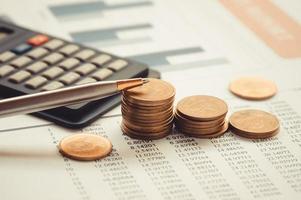 moedas com calculadora foto