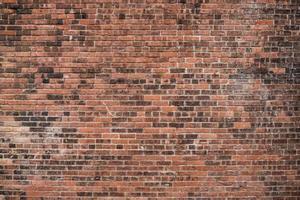 velha parede de tijolo vermelho foto