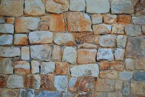 fundo texturizado de parede de pedra laranja foto