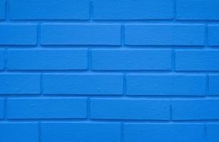 uma parede de tijolo azul índigo, fundo de textura de construção foto