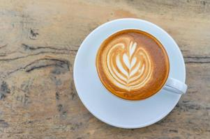 xícara de café latte art foto