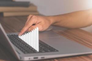 símbolo de gráfico de barras de crescimento de negócios do computador foto