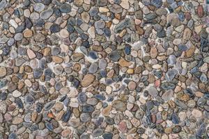 textura do chão de cascalho e seixos foto