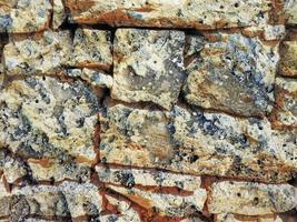 detalhe da parede de pedra ao ar livre para plano de fundo ou textura foto