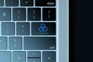 2018 - editorial ilustrativo do símbolo jsecoin sobre teclado de computador foto