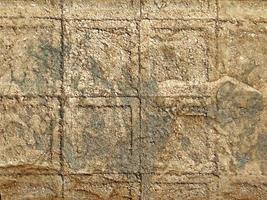 rocha ou parede de pedra para plano de fundo ou textura foto