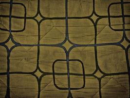 xadrez e desenhos geométricos em tecido para plano de fundo ou textura foto