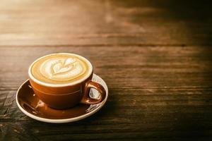 xícara de café com leite foto