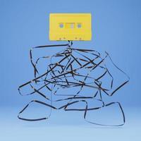 velho cassete amarelo com a fita enrolada embaixo, renderização em 3D foto