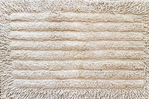 tecido de close-up de toalha marrom e fundo de textura