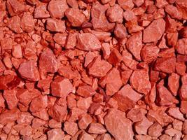close-up de pedra vermelha ou parede de rocha para plano de fundo ou textura foto