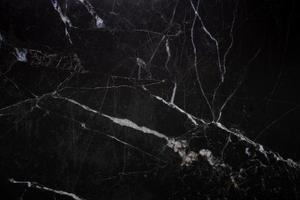 textura de mármore preto natural para papel de parede de telha de pele fundo luxuoso, para trabalho de arte de design foto