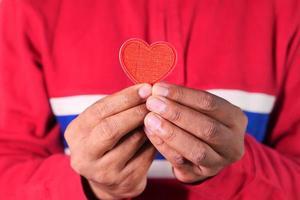 mão com coração foto