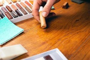 restauração de laminado e parquet para vedação de riscos e lascas foto