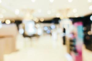 Resumo desfocado do interior do shopping para o fundo