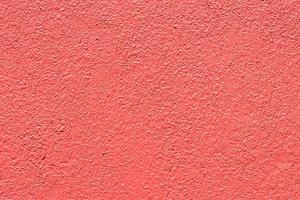 fundo de parede de concreto rosa e vermelho foto