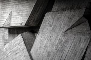 padrão de fundo abstrato de estrutura de parede de edifício de concreto cinza com sombra foto