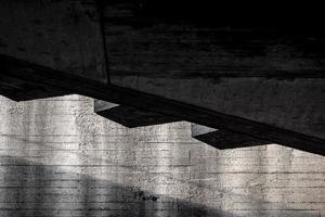 fundo abstrato da estrutura da parede do edifício de concreto cinza com sombra foto