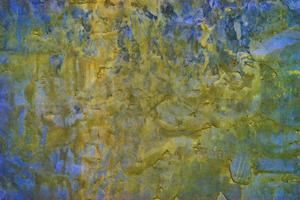 fundo de concreto na cor azul-amarela com textura grande. foto