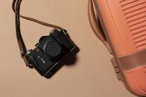 câmera e fundo de bagagem foto