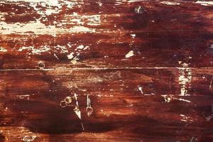 textura ou fundo de madeira pintada de vermelho antigo foto