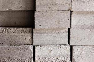 fundo de edifício de tijolo branco ou material de construção foto