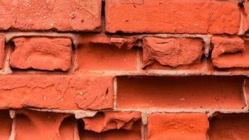 close-up de fundo de textura de parede de tijolo vermelho velho foto