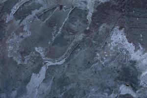 textura do velho muro de concreto cinza para o fundo foto