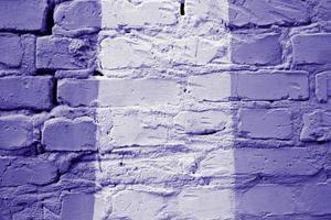 close-up de fundo de textura de parede de tijolo multicolorido antigo foto