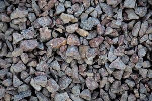 pedra cinza esmagada no fundo de textura do solo foto