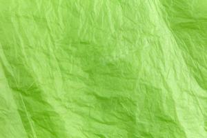textura abstrata de saco de lixo de celofane verde foto