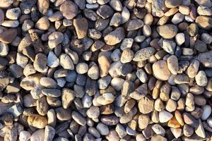superfície de cascalho textura de pedras de fundo de cascalho foto