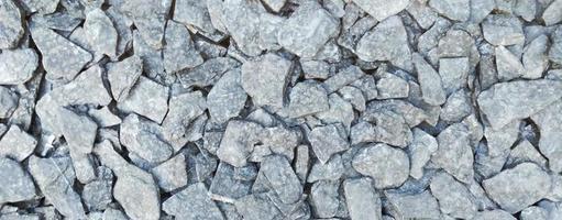 as rochas e o fundo do padrão de textura de pedra foto