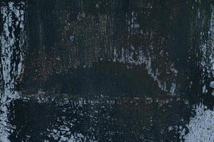 estrutura de ferro, amassados e arranhões de fundo preto velho e desgastado foto