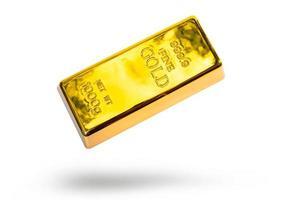 barra de ouro em fundo branco foto