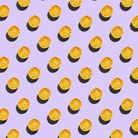 padrão repetitivo feito de fatias de laranja secas em fundo rosa foto