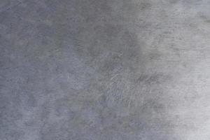 textura de metal riscada, fundo de placa de aço escovado foto