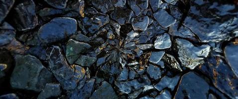 as rochas molhadas e o fundo do teste padrão da textura da pedra. foto