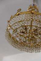 lustre de cristal e latão para sala de estar foto