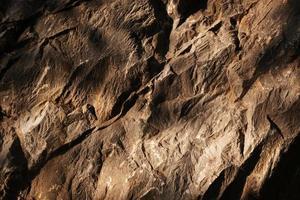 textura de fundo de rocha, parede de pedra foto
