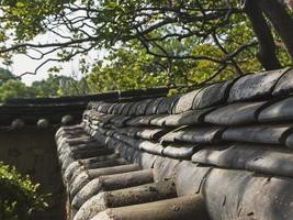 cerca de pedra velha em aldeia tradicional da Coreia do Sul foto