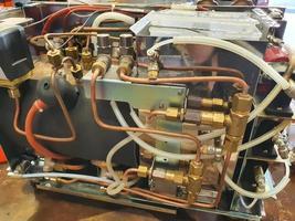 máquina de café sem corpo em manutenção foto