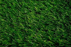 vista superior da grama artificial verde. revestimento de pavimentos. fundo, copie o espaço foto