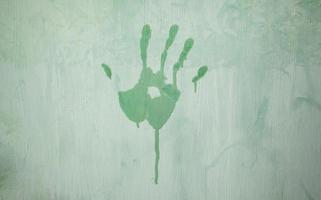 marca de mão em uma parede foto
